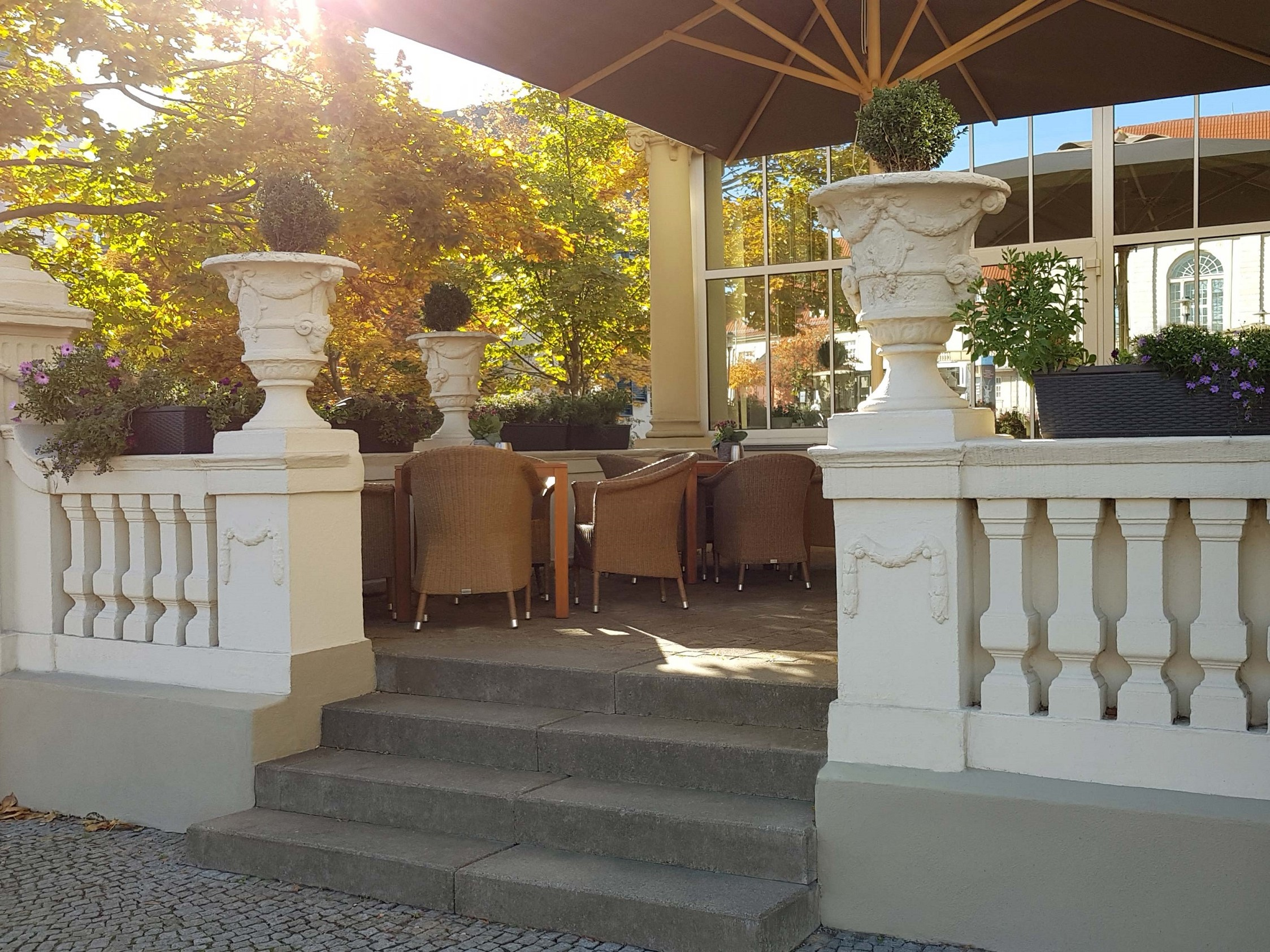 The terrace of the hotel with comfortable wicker armchairs and colorful flower boxes.